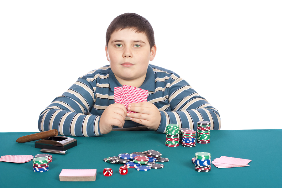 bigstock-Boy-Playing-Poker-15766037