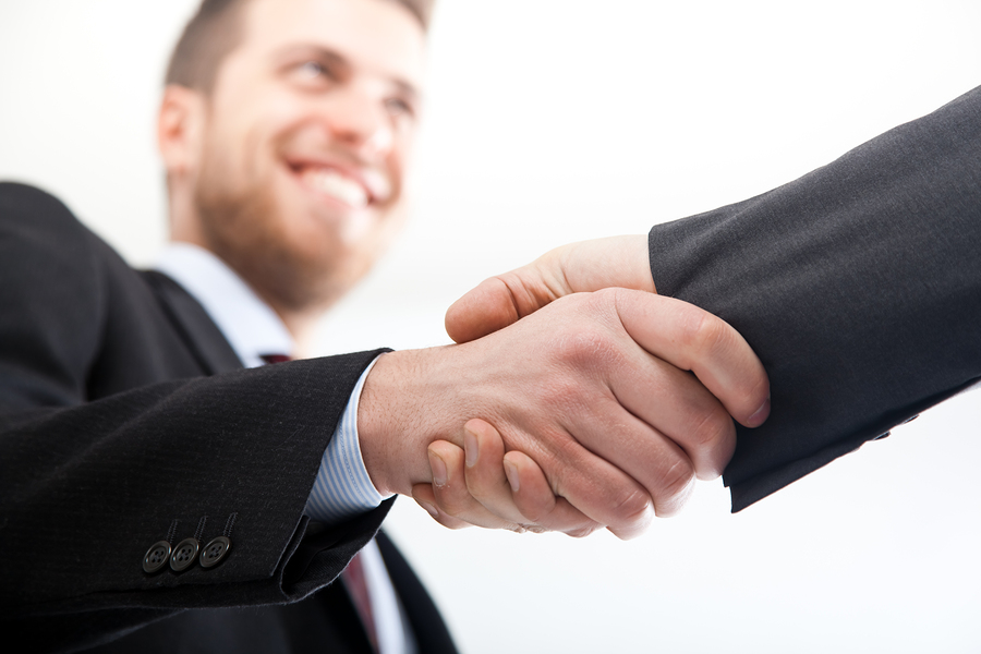 bigstock-Two-businessman-shaking-hands-26976686