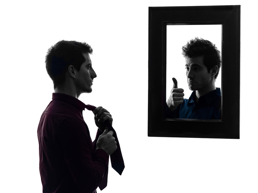 bigstock-man-in-front-of-his-mirror-ma-45742546